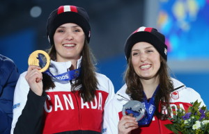 PHOTO: Streeter Lecka/Getty ImagesGold medallist Marielle Thompson (left) and silver-medal winner Kelsey Serwa joined the parade of Canadian athletes to the podium on Friday at the Sochi Winter Games.
