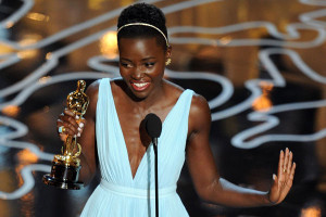 Actress Lupita Nyong'o accepts the Best Performance by an Actress in a Supporting Role award for '12 Years a Slave' onstage during the Oscars. Photo:Getty Images/AFP