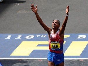 Meb Keflezighi of the United States reacts as he crosses the finish line. Photo : USA TODAY Sports