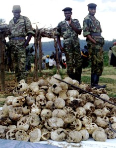 Ethnic Tutsi Rwandan Patriotic Front troops look over a pile of